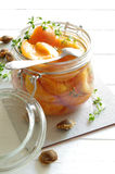 Stewed apricots wiht thyme in a jar Royalty Free Stock Image