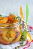 Stewed apricots wiht thyme in a jar Stock Image