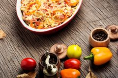 Diet vegetarian vegan food. Stewed, baked zucchini, tomatoes and peppers.Traditional French vegetable dish stock image