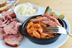 Stewed beans in tomato sauce with smoked ham hock meat pickles and coleslaw Royalty Free Stock Photos