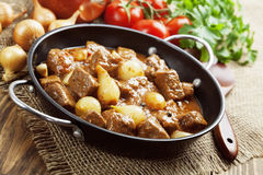 Stewed beef with onions and tomatoes, stifado Royalty Free Stock Photo