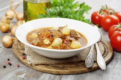 Stewed beef with onions and tomatoes, stifado Royalty Free Stock Image