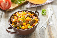 Stewed beef with pumpkin and tomatoes Royalty Free Stock Photos