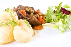 Stewed beef steak with potatoes and salad Stock Photos