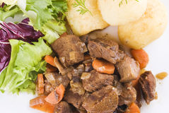 Stewed beef steak with potatoes and salad Royalty Free Stock Photos