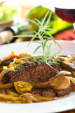 Stewed beef in the wine. With green beans on the plate Royalty Free Stock Photo