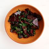 Stewed beetroot with chard in clay bowl Stock Photography