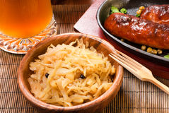 Stewed cabbage. Cabbage with sausages and beer royalty free stock photo