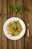 Stewed cabbage with broccoli and chard leaves. On a white plate Royalty Free Stock Image