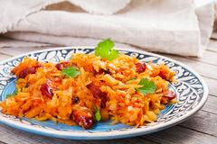 Stewed cabbage with sausages, carrot, onion and tomatoes. Royalty Free Stock Photography