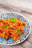 Stewed cabbage with sausages, carrot, onion and tomatoes. Royalty Free Stock Images