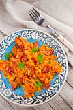 Stewed cabbage with sausages, carrot, onion and tomatoes. Stock Photography