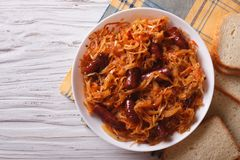 Stewed cabbage with sausages horizontal top view Stock Photography