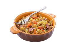 Stewed cabbage with smoked sausages in ceramic pan Stock Photos
