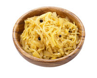 Stewed cabbage in a wooden bowl. Isolated on white background stock photo