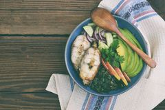 Stewed chard with apples, avocado, fish and salad of cucumbers, onions. AIP breakfast, dinner or lunch. Autoimmune Paleo. Diet hea. Lthy food concept. Cereals stock images