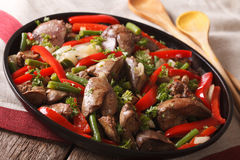 Stewed Chicken liver with onion and pepper close-up. horizontal Stock Photography