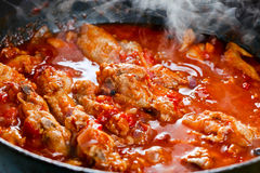 Stewed chicken in tomato sauce Stock Photos