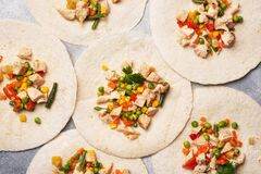 Free Stewed Chicken With Vegetables Corn Pepper Tomato Peas Beans On Tortillas. Filling For The Mexican Dish Quesadilla Stock Photos - 178687143