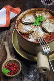 Stewed eggplant and wineglass Stock Images