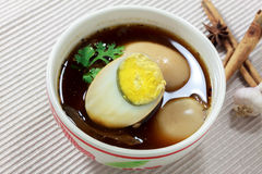 Stewed eggs or eggs and pork in brown sauce by Thai food. Royalty Free Stock Photo