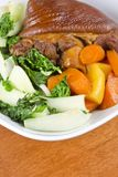 Stewed Ham Hock Served with Vegetables Stock Images