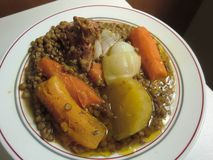 Stewed lentils with pumpkin, carrot, potato and pork meat. A delicious dish of stewed lentils with cooked potato, pumpkin, carrot, a portion of succulent pork stock photography