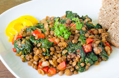Stewed lentils with spinach, pepper and onion Royalty Free Stock Photos