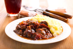 Stewed liver with plums and gravy Stock Images