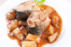 Stewed mackerel fish pieces with potatoes Stock Image