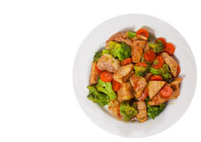 Stewed meat with broccoli and carrot. top view. isolated Stock Images