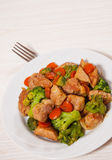 Stewed meat with broccoli and carrot Royalty Free Stock Photography