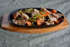 Stewed meat. In a frying-pan cooked with vegetables Royalty Free Stock Photos