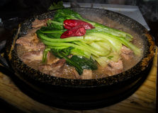 Stewed meat with spinach and chilli Stock Images