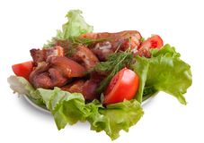 Stewed meat with tomatoes Stock Photo