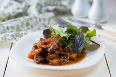 Stewed meat with vegetables Stock Photos