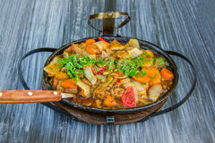 Stewed meat with vegetables. In a frying pan Royalty Free Stock Image