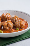Stewed meatballs with peas, tomato and onion Royalty Free Stock Photos