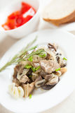 Stewed Mushrooms And Onions On A White Plate Stock Photo
