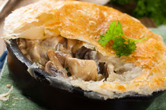 Stewed mushrooms under puff pastry. Stewed mushrooms with cream and parsley under puff pastry. Healthy food concept royalty free stock image