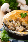 Stewed mushrooms under puff pastry. Stewed mushrooms with cream and parsley under puff pastry. Healthy food concept stock photography