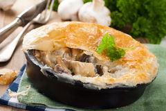 Stewed mushrooms under puff pastry. Stewed mushrooms with cream and parsley under puff pastry. Healthy food concept stock photos