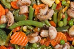 Stewed mushrooms with vegetables macro background Stock Image