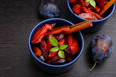 Stewed plums. Dessert, stewed plums with cinnamon stock photography