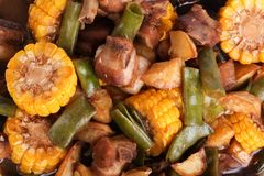 Stewed pork with beans and corn. Chinese style royalty free stock photos