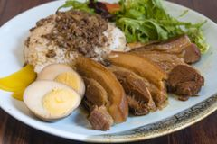 Stewed pork belly rice stock image