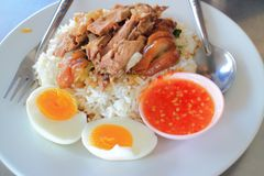 Stewed pork leg and egg on rice Stock Images