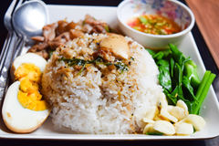 Stewed pork leg on rice Stock Images