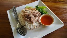 Stewed pork leg on rice. Food design art wood table Stock Photos