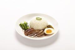 Stewed pork leg on rice Stock Photos